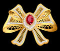 shiny gold bow brooch with mesh and jewels