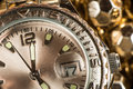Shiny gold color watch studio macro shot Royalty Free Stock Photo