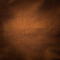 Shiny gold leather background close up Stock Photo