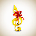Shiny golden g-clef with ribbon. Royalty Free Stock Photo