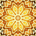 Shiny golden kaleidoscope star Stock Images
