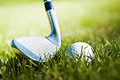 Shiny golf club and ball on the grass Royalty Free Stock Photo
