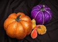 Shiny gourds an arrangement of gourd shapes in various colors and covered in giitter Royalty Free Stock Images