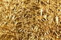 Shiny metal yellow golden texture background. Metallic gold pattern Royalty Free Stock Photo