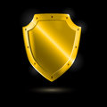 Shiny metallic golden shield on black vector illustration Royalty Free Stock Images