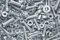 Shiny nuts bolts background Stock Photos