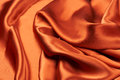 Shiny orange copper silk Royalty Free Stock Photo
