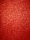 Shiny red grainy texture surface of the lighted paper or wall Stock Photos