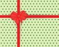 Shiny red satin ribbon on green dots background Royalty Free Stock Photo