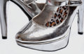 Shiny shoes silver high heel with leopard print soles for women Royalty Free Stock Image