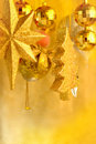 Shiny tree gifts and fire in christmas and newyear golden color Royalty Free Stock Photo