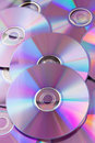 Shiny violet CDs DVDs Stock Photos