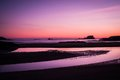 Ship across the ocean at sunset in tofino beach vancouver island canada Royalty Free Stock Photos