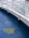 Ship deck safety hazard warning painted in yellow on the of a cruise Royalty Free Stock Images