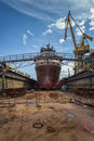 Ship in dry dock at the shipyard Royalty Free Stock Photo