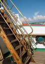 Ship gangway between the two decks of the view from the of the surroundings wooden staircase and marine equipment on an Royalty Free Stock Image