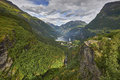 Ship in the Geiranger fjord, listed as a UNESCO World Heritage Site Royalty Free Stock Photo