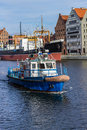 Ship harbour master flowing into gdansk floating on the river in poland Stock Image