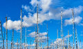 Ship masts against blue cloudy sky. Royalty Free Stock Photo