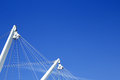 Ship masts with rigging on blue summer sky background Stock Images