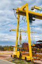 Ship and monumental crane in the shipyard big Stock Photography