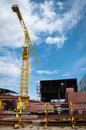 Ship and monumental crane in the shipyard big Stock Photos