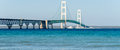 Ship passes under the Mackinac Bridge in Michigan Royalty Free Stock Photo