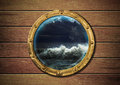 Ship porthole with storm Royalty Free Stock Photo