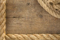 Ship ropes and knot on wood background Royalty Free Stock Image