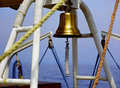 Ship s bell on the old Stock Images