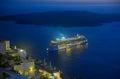Ship sailing away from Santorini at night Royalty Free Stock Image