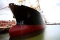 Ship in a shipyard dock large red and black tanker being renovated Stock Photography