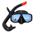The ship tail-long at ocean landscape is reflected in diving mask and snorkel on the beach Royalty Free Stock Photo
