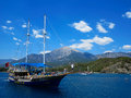 Ship with tourists swimming in the sea on a backgr kemer turkey june tourist from around floats mediterranean along coast tour of Stock Photos