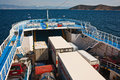 Ship transporting cargo and passengers cars to an island in greece Royalty Free Stock Images