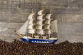Ship waves from the coffee beans pictures beautiful background view  the side wooden table. The concept of expand Royalty Free Stock Photo
