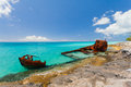 Ship wreckage on a beach peaceful in the caribbean Stock Image