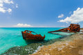 Ship wreckage on a beach rusty peaceful in the caribbean Royalty Free Stock Photos