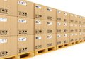 Shipment logistics delivery product distribution business industrial concept storage warehouse row stacked cardboard boxes packed Royalty Free Stock Photography