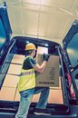 Shipment van delivery men reloading cargo from the shipping and logistic theme Royalty Free Stock Photos