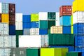 Shipping container stack in diverse harmonious colors a port Royalty Free Stock Image