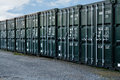 Shipping containers line of new freight being used a a self storage solution Stock Images