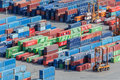 Shipping containers stacked up at a shippiing port Stock Photo