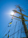 Ships mast flags and sunburst the sun bursting behind a flag of an old tall ship it s Stock Images