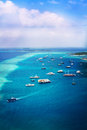 Ships in ocean near beach in Maldive Island Stock Image