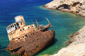 Shipwreck on amorgos island scenic view of rusty rocky coastline of cyclades islands greece Royalty Free Stock Photography