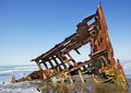 Shipwreck on a beach Stock Photography