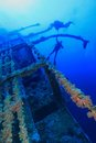 Shipwreck and divers scuba at the of the numidia in the red sea Stock Photos