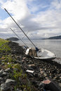 Shipwreck on shore with ground underneath boat Royalty Free Stock Photography