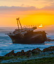 Shipwreck at sunset over a cape agulhas Royalty Free Stock Images